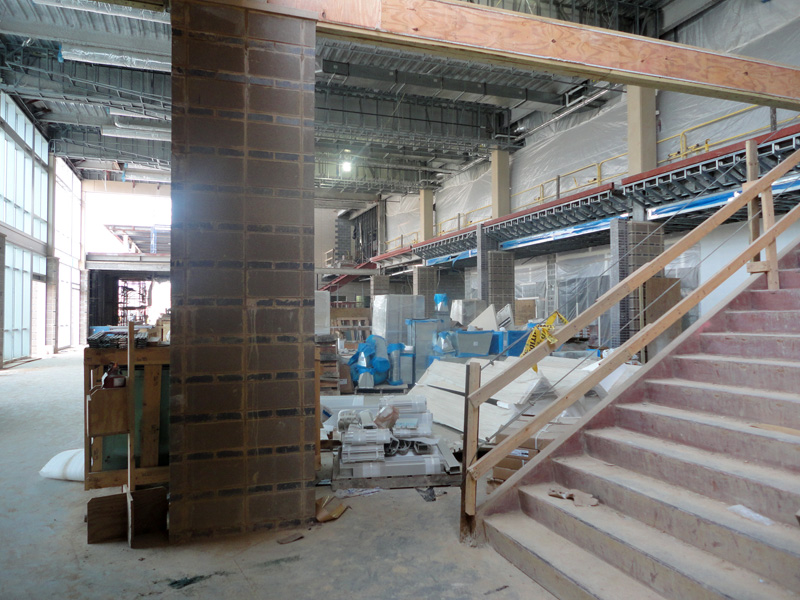 Showing a staircase just inside the building where the Town Hall will be